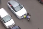 Video footage of the incident shows the car, which had ploughed through a police road block, driving head-on into the woman as she crossed the road. Photo / YouTube