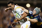 James Lowe of the Chiefs evades the tackle of David Pocock of the Brumbies. Photo / Getty Images.
