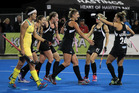 WINNING FEELING: Black Sticks celebrate the match-winning goal of Pippa Hayward (first from left of Aussie defender) in Hastings tonight. PHOTO/Duncan Brown