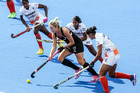 New Zealand's Sophie Cocks surges past two Indian players. Photo / Paul Taylor