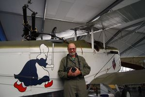 Philip Makanna in The Vintage Aviator hangar beside a DH-4, one of several World War I planes he photographed from the air last week. PHOTO/ALISA YONG