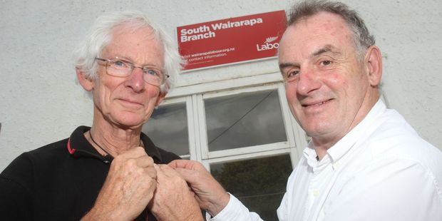 Labour Party long-termer Don Farr, Carterton (left) receives a gold pin from Hutt South MP Trevor Mallard. PHOTO/ANDREW BONALLACK