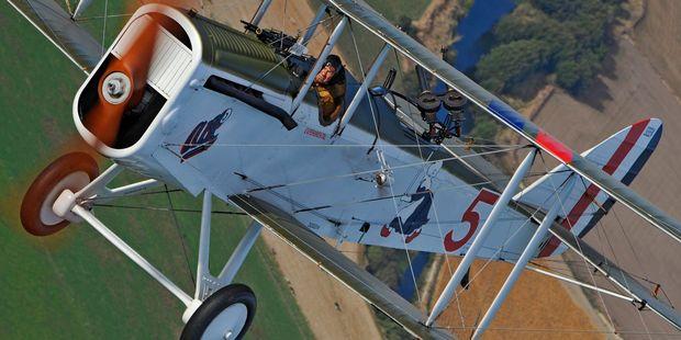 Aviation photographer Philip Makanna captures pilot Gene DeMarco in a World War I DH-4 fighter plane. PHOTO/PHILIP MAKANNA