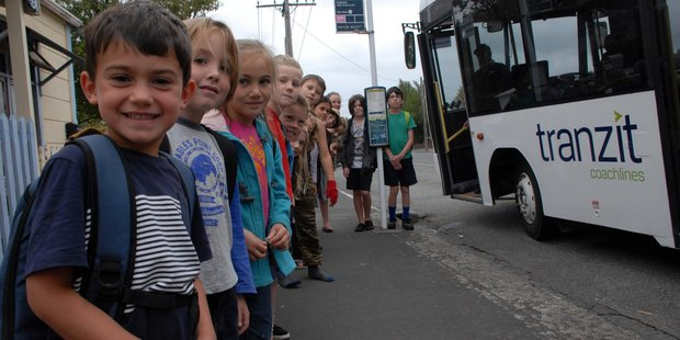 The 30 Masterton Montessori pupils at South End School in Carterton wait in line after class got out yesterday for their free bus ride back home again. PHOTO/NATHAN CROMBIE
