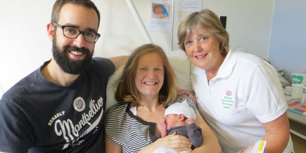 Ed and Marijke Bell, who used hypnobirthing techniques, with 3-day-old Frieda and midwife Carole Wheeler. PHOTO/SUPPLIED