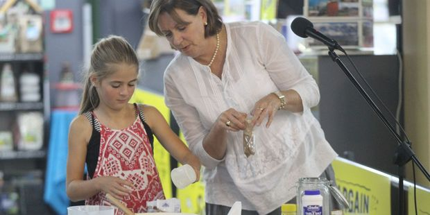 Author and cook Allyson Gofton, right, checks on progress with Greta Matthews during a baking demonstration at Paper Plus Masterton. PHOTO/SUPPLIED