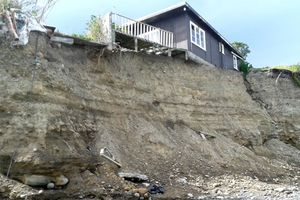 This bach near Whatarangi on Cape Palliser Rd is one of two deemed dangerous under the Building Act and South Wairarapa District Council says they must go.