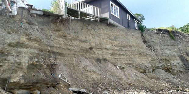 This bach near Whatarangi on Cape Palliser Rd is one of two deemed dangerous under the Building Act and South Wairarapa District Council says they must go. PHOTOS/SUPPLIED
