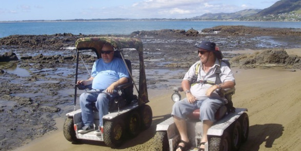 MADE IT: Bryce McFall (left), with Ahipara resident and friend Kevin Griffiths, finally made it to 90 Mile Beach.