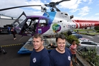 Trustpower TECT Rescue Helicopter pilots Liam Brettkelly and Todd Dunham at the Ian Pain Memorial Hanger at Tauranga Hospital yesterday. Photo / George Novak