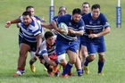 Judea players Henry Anderson (with ball) and Rana Kapene-Paitai on the charge with Rangiuru players in pursuit.