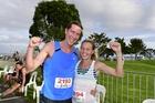 Defending champions Ben and Jesse Ruthe celebrate winning the men's and women's titles at last year's Tauranga Half Marathon.