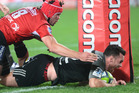 Ryan Crotty of the Crusaders scores against the Lions. Photo / Getty