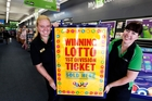 Whangarei Paper Plus staff Samantha Morgan left and Michelle Nicolson have a new sign to hang in their Cameron St Mall shop after one Lotto winner claimed a $333,333 First Division prize yesterday. Photo / John Stone