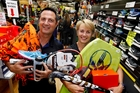 Whangarei's Stirling Sports owners Donna and Mark Newman sort out some of the sports gear they hope to sell before the shop closes on May 27. Photo / John Stone