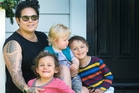 Anika Moa with her children, Soren and twin boys Taane and Barry, at her Avondale home. She is looking for a venue for her Whangarei show on April 29.