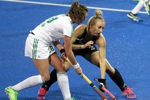 Irish player Deirdre Duke goes up against Black Stick Sophie Cocks. Photo / Paul Taylor