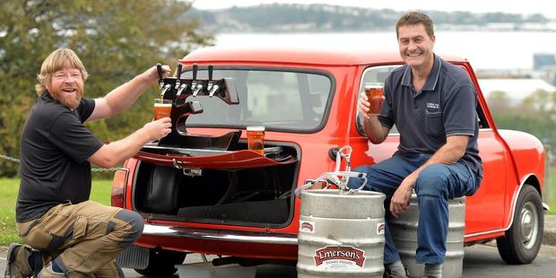 Emerson's Brewery founder Richard Emerson (left) and Castle Street Panel Beaters director Nigel Constable share a cold one from the new Emerson's Mini Bar. Photo / Stephen Jaquiery, Otago Daily Times