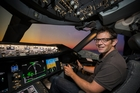 Greg Bowker in Air New Zealand's Dreamliner simulator. Picture / David Morgan