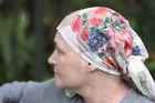There she was on Thursday afternoon with her headscarf and her green eyes, a visitor from Wellington sitting in a large chair with a footrest in the really quite pleasant wards of the Canopy Cancer Centre at Mercy Hospital in Epsom, hooked up to two bags of chemo.