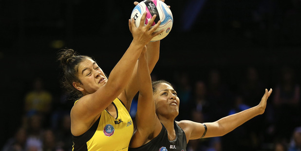 Maia Wilson of the Pulse battles for the ball with Kristiana Manu'a of the Magic. Photo / Getty