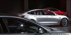 Watch: Watch: Tesla unveils its Model 3 electric car
