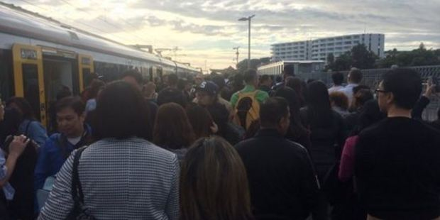 Daniel Woo posted this photo on Twitter of train passengers stranded at The Strand. Photo / Twitter-Daniel Woo