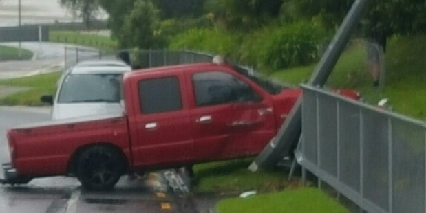 A ute has crashed into a fence on Fraser Rd in Tauranga. Photo/supplied