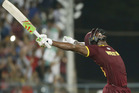 West Indies Carlos Brathwaite celebrates after they defeated in England in the World T20 final. Photo / AP