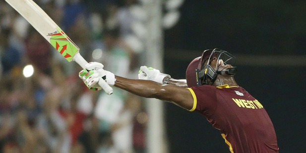 Loading West Indies Carlos Brathwaite celebrates after they defeated in England in the World T20 final. Photo / AP