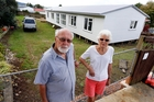 Onerahi residents Brian and Ann Hewitt said they would like to have been notified about a Housing New Zealand pre-fab which suddenly appeared near their Ross St home. Photo / John Stone