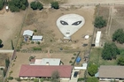 A farmer arranged rocks into an 18m by 27m extraterrestrial face in his Rosmoland, California backyard