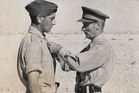Captain William Porter, later promoted to major, is awarded the Bar to his Military Cross from Field Marshal Bernard Montgomery.