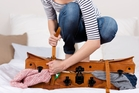 It's a suitcase, not a wardrobe. Photo / 123RF