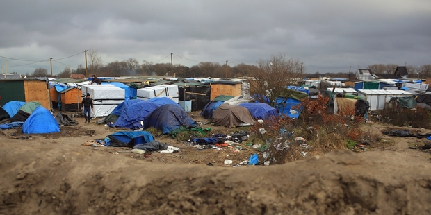 """One Kiwi volunteer described  the atmosphere of the  Calais  migrant camp known as the """"jungle"""" as desolate and sombre. Photo / AP"""