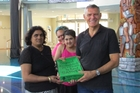 Sushila Butt, with daughter Alisha and her support worker Georgia Tait, give Green MP David Clendon a petition calling for medical cannabis to be funded for other epilepsy patients.