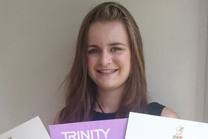 Annemieke Hendriks with the certificates from the prestigious Trinity College London.