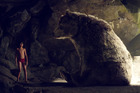 Mowgli, played by Neel Sethi, and Baloo the bear, voiced by Bill Murray, appear in a scene from The Jungle Book. Photo/AP