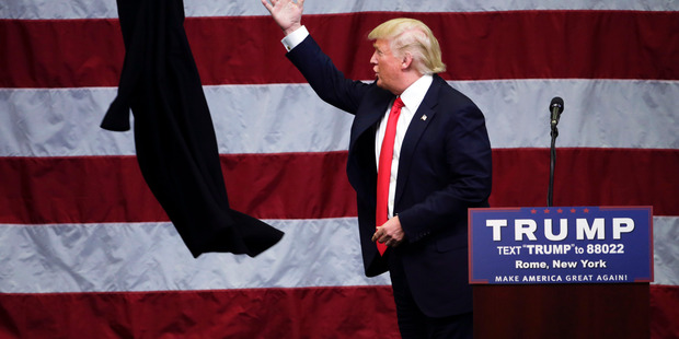 Republican presidential candidate Donald Trump tosses his coat during a rally in Rome, New York. Photo / AP