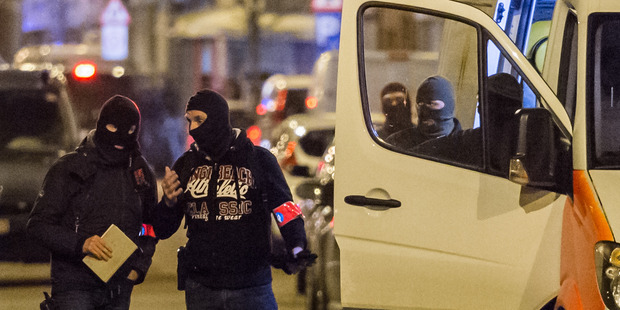 Police investigate an area where terror suspect Mohamed Abrini was arrested in Brussels. Photo / AP