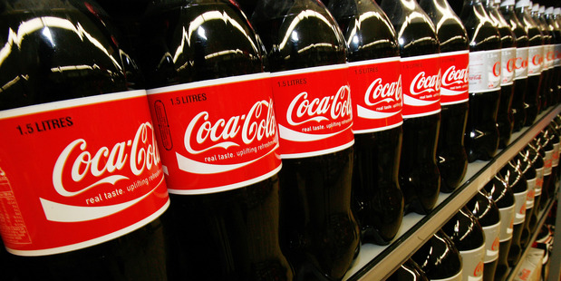 Coke lines the shelves in a supermarket. There's a new study on the advantages of a sugary drinks tax.