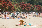 Auckland holiday makers enjoy the summer heat at Mission Bay. Photo: Greg Bowker
