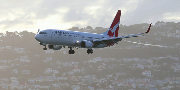 A Qantas jet landing at Wellington International Airport. Photo / Mark Mitchell