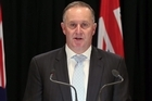 Prime Minister John Key defends Government's decision over the Kermadec Islands during the conference.