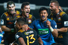 (L-R) Stephen Donald,James Lowe and Aaron Cruden celebrate the try from Seta Tamanivalu (13). Photo / Getty Images.