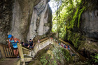 Waitomo Trail runners surrounded by towering rock formations leading up the staircase. Photo/Kurt Matthews Photography