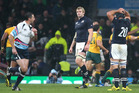 Craig Joubert, the referee, sprints off the pitch after the final whistle as Scotland are defeated during the 2015 Rugby World Cup. Photo / Getty Images.