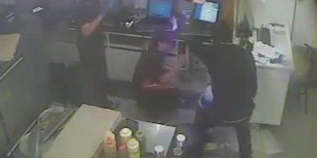 Loading Police today released footage of the incident at Domino's Pizza in Glenfield, on the North Shore, which was captured on CCTV camera. Photo / Supplied