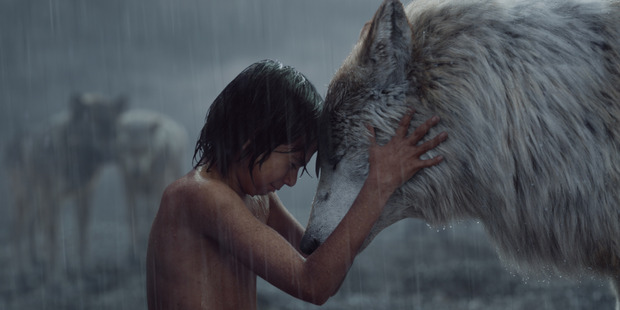 A scene from The Jungle Book, starring Neel Sethi as Mowgli and Lupita Nyong'o voicing Raksha.