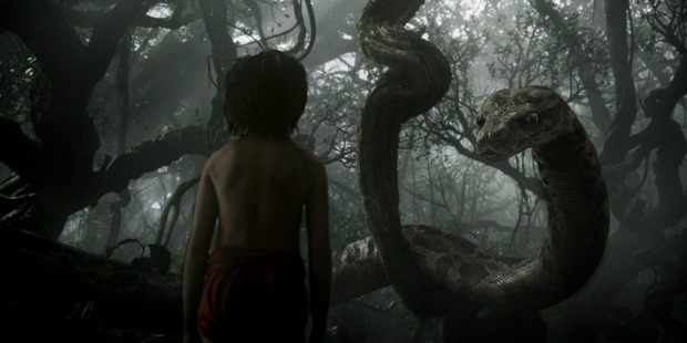 Mowgli (newcomer Neel Sethi) meets Kaa (voice of Scarlett Johansson) in The Jungle Book.